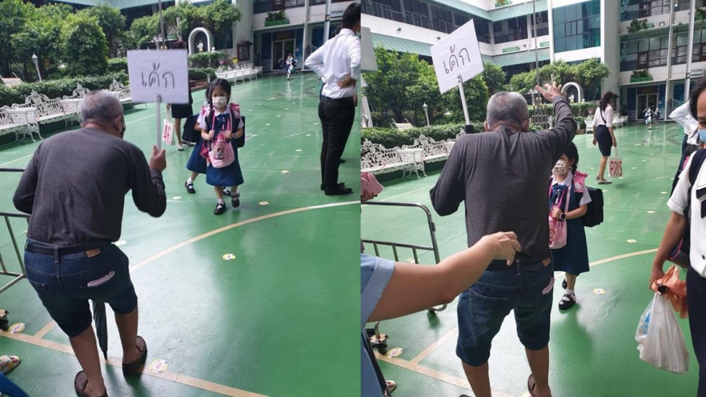 Thai grandpa creates a signboard to easily find his grandkid among many masked kids in school