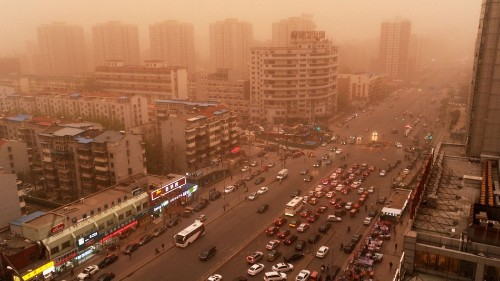 'Like the end of the world': Beijing blanketed in red dust