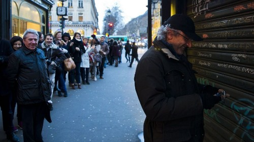 The hunt for Charlie Hebdo: Paper sells out in minutes across Paris