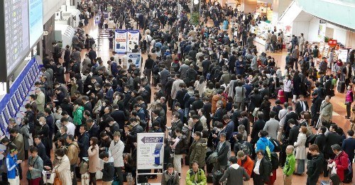 Airline system glitch in Japan grounds 120 flights, leaves 16,000 stranded