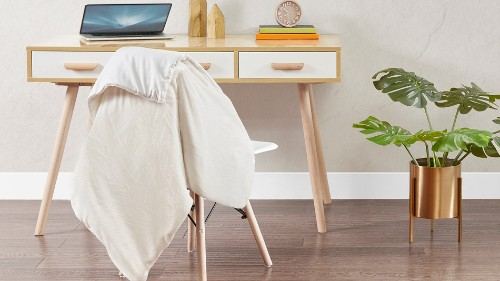 This fuzzy weighted blanket is reversible and on sale for under $40
