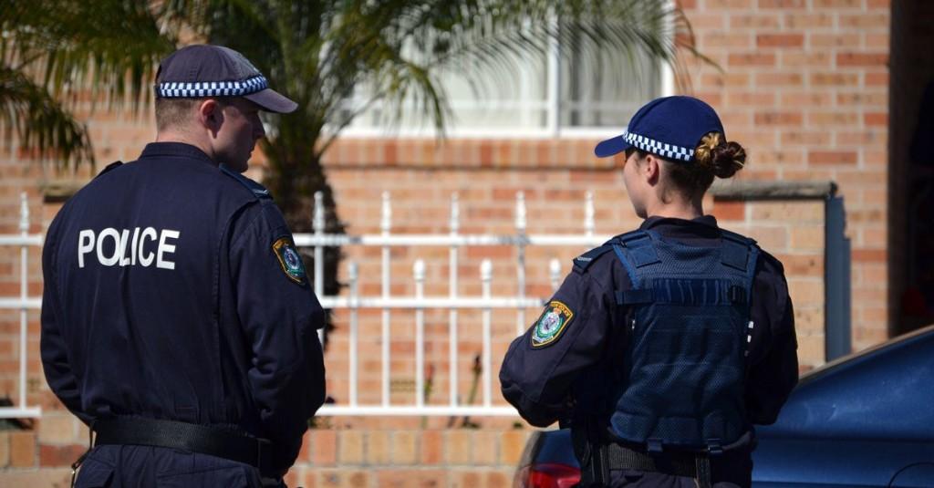 Two people, including boy, arrested in terror raids in Sydney, Australia