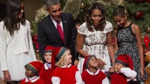 Adorable Elf Photobombs Obamas' Christmas Card
