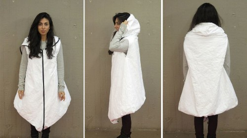 Prototype coat for refugees doubles up as a tent or sleeping bag