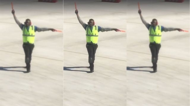 Airport worker dances on the tarmac like no one's watching to make air travel less painful
