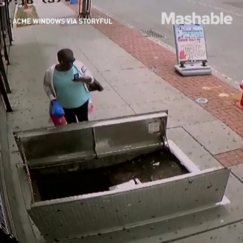 Woman fell into an open hatch because she was too busy looking at her phone