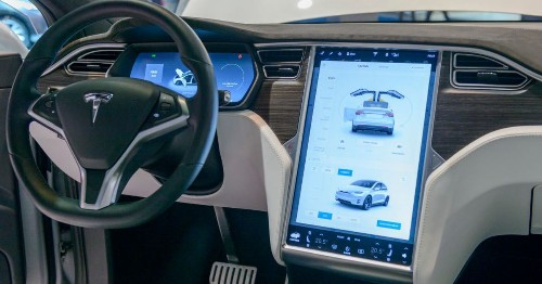 Tesla driver was playing iPhone game during crash. Investigators blame Tesla and Apple.