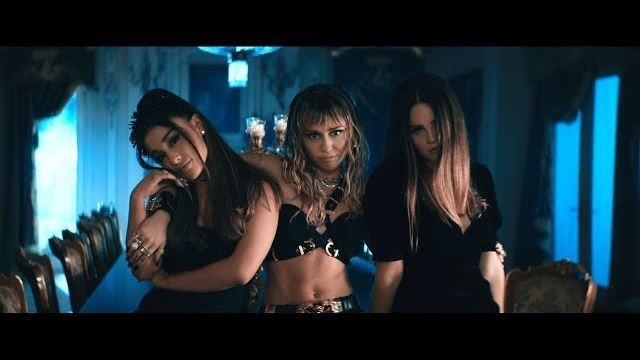 Ariana Grande, Miley Cyrus, and Lana Del Rey pair their wings with weapons and wine in 'Don't Call Me Angel' video