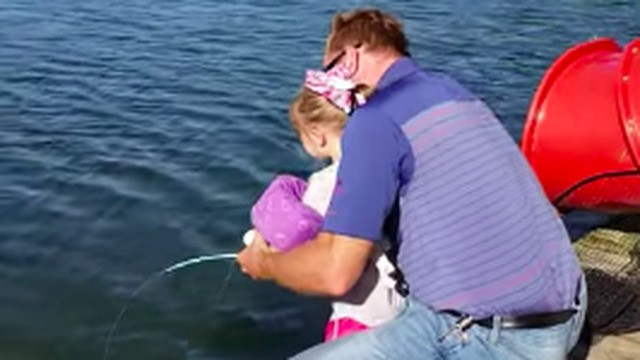 Watch a kid reel in a 30-pound fish with her 'Frozen' mini pole