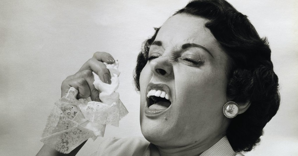 Stop sneeze-shaming. It isn't even a coronavirus symptom.
