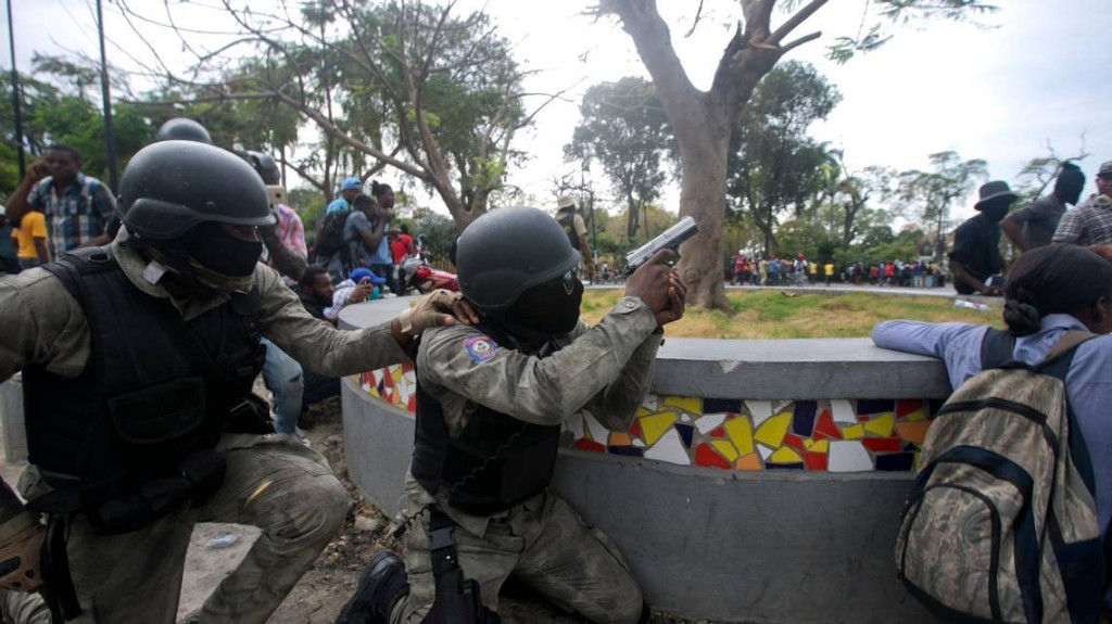After another day of violent protests, Haiti to allow police to unionize
