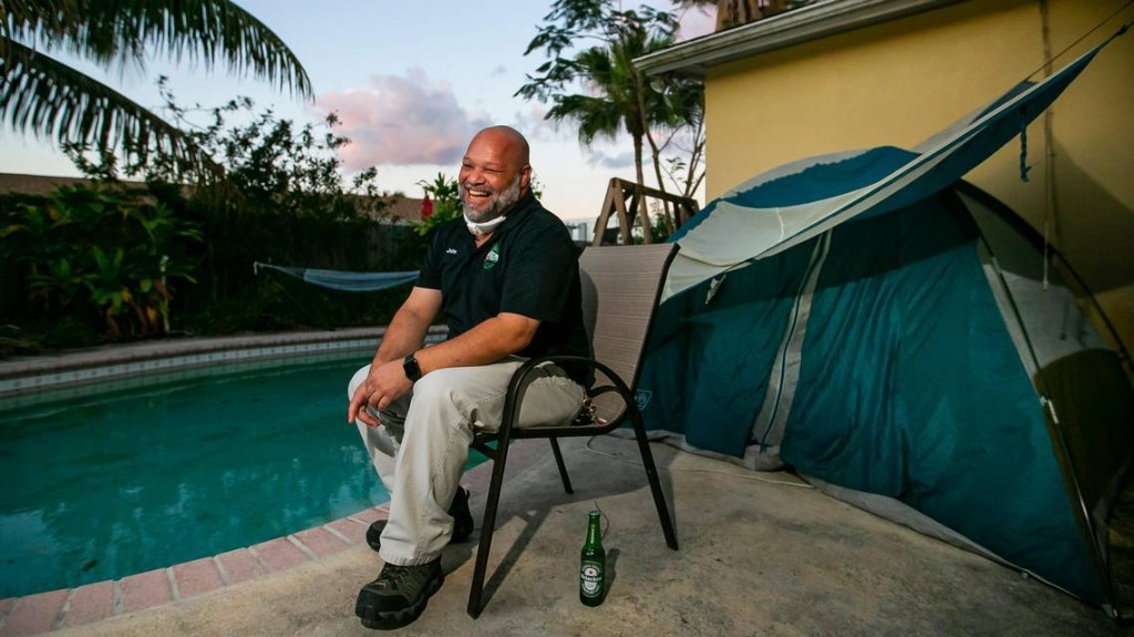 'Too much to lose.' Why a Miami man moved into a backyard tent during coronavirus crisis