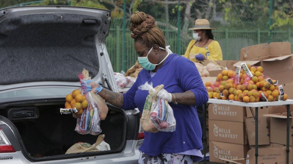 Free food is available in Miami, but in the age of conoravirus you need a car to get it