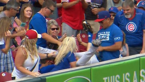 Tommy La Stella dives into stands for catch on Joey Votto