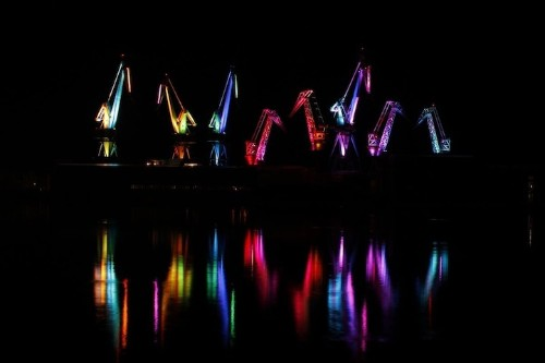 Colorfully Illuminated Cranes Produce a Dancing Light Show