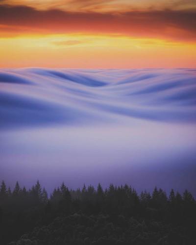 Enchanting Long-Exposure Photo of Full Moon Illuminating Fog Over California