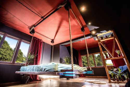 Remote-Controlled Bed Hangs from the Ceiling Like a Hammock