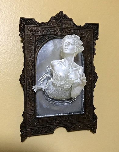 Spooky Wall Sculptures of Victorian Ghosts Emerging from a Mirror