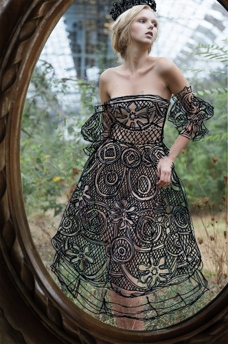 Elaborate Dresses Hand-Drawn on Perfectly Aligned Mirror