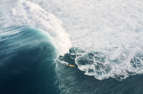 Interview: Aerial Photos Capture Surfers Conquering Giant Swelling Waves