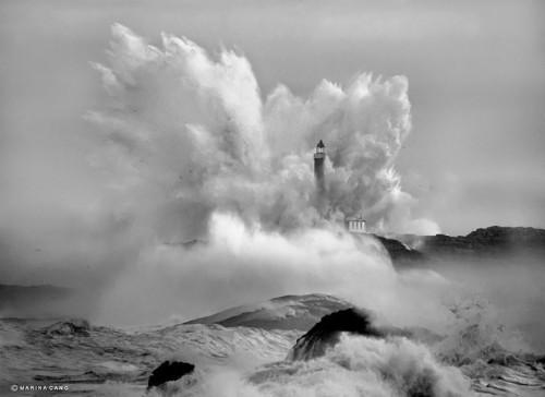 Powerful Ocean Waves Consume a Single Lighthouse