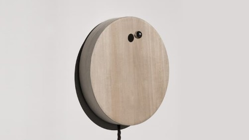 Modern and Minimalist Timepiece Tells Time with a Levitating Sphere