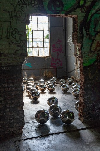 Yayoi Kusama Installation Fills Abandoned Building With 1,500 Mirrored Spheres