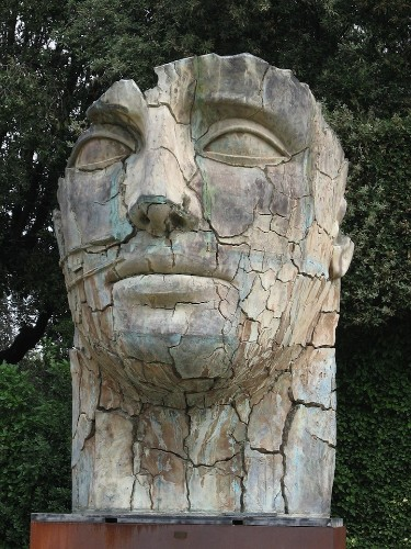 Giant Cracked Face Statue Depicts Strength and Fragility