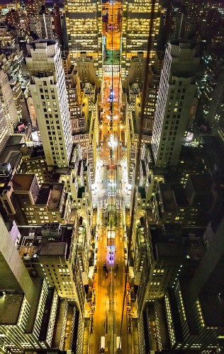 Amazingly Symmetrical Reflections of NYC Captured from the Tops of Skyscrapers