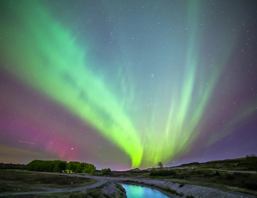 Interview: Gorgeous Landscapes Heightened by Auroras Illuminating the Night Sky