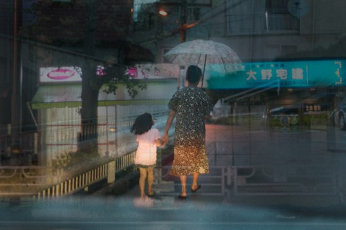 Japanese Taxi Driver Takes Multiple Exposures While Looking for Passengers