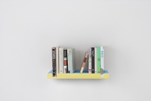 Clever Minimal Bookshelf Uses Books as Bookends