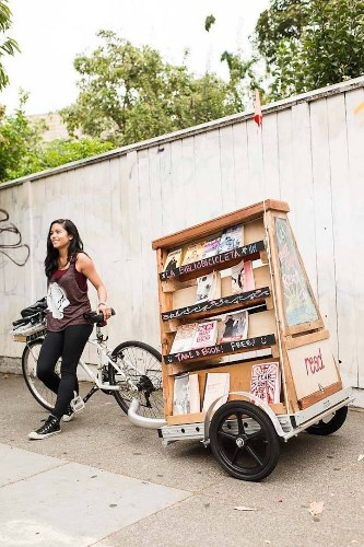 Librarian Rides Around on Pop-up Bicycle Book Library to Spread the Joy of Reading