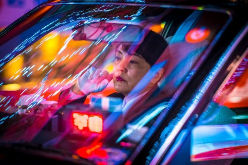 Candid Photos Reveal the Stoic Faces of Tokyo's Nighttime Taxi Drivers