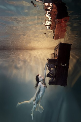 Graceful Photo Shoot Staged Completely Underwater