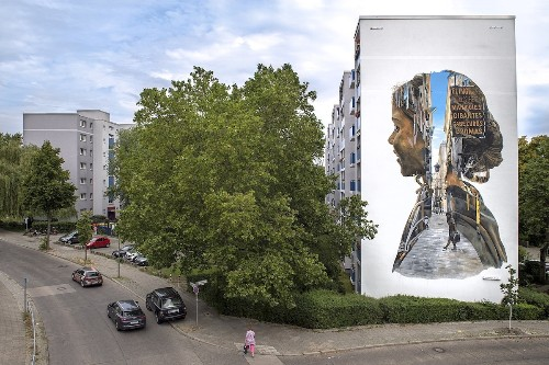 Giant Painted Mural Looks Like a Double Exposure Photo on the Side of a Building