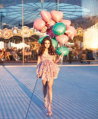 Mila Kunis Goes Around the Carousel for Bazaar