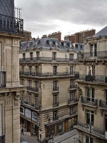 Voyeuristic Photos Capture Intimate Scenes Through Apartment Windows in Paris