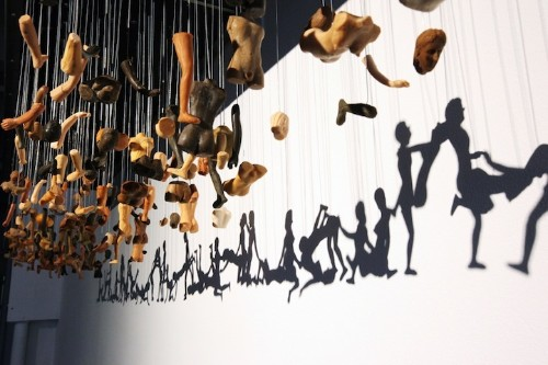 Provocative Shadow Art Created Through Suspended Doll Parts