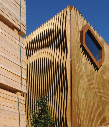 Stunning Wood Facade Appears as Rippling Waves on an Office Building