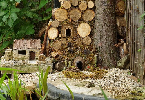 Photographer Builds Tiny Village for Adorable Family of Mice Found Living in His Garden