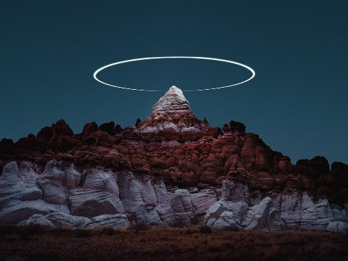 """Long Exposure Photos Capture Drones """"Painting"""" Light Halos Over Mountains"""