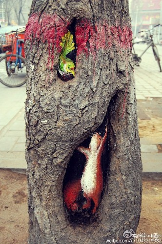 Spectacular Tree Hole Paintings Brighten Up China's Streets