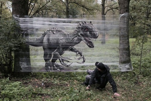 Graffiti Artist Spray-Paints Giant Animals onto Plastic Wrap in a Forest