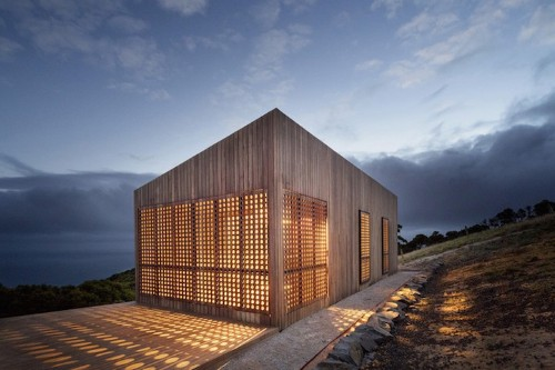 Windy Seaside Cabin Dazzles at Night with Decorative Timber Screens