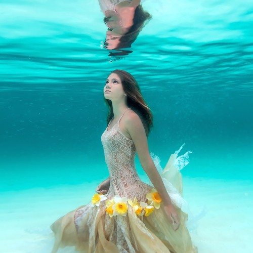 Ethereal Underwater Photos Capture Young Woman's Deep Connection with the Sea