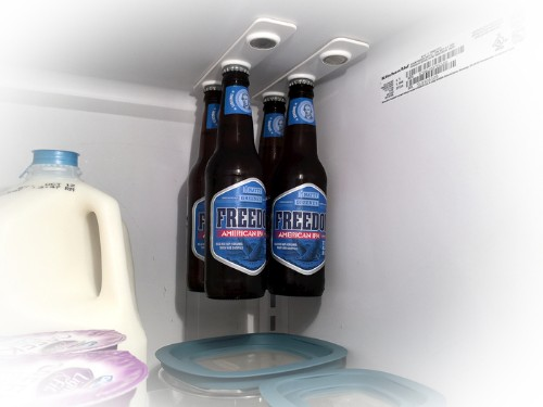 Space Saving Magnetic Strips Hang Glass Bottles from Fridge Ceiling