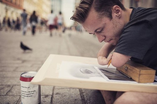 Artist Born Without Hands Creates Masterful Photo-Realistic Portraits