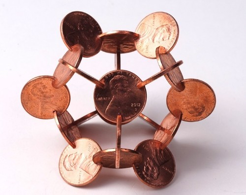 Interlocked Coins Form Complex Geometric Sculptures