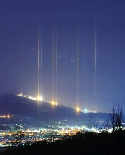 Streaking Light Pillars Illuminate the Night Sky